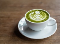 Matcha latte in white cup